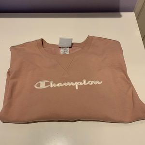 Blush pink Champion crew neck sweatshirt.
